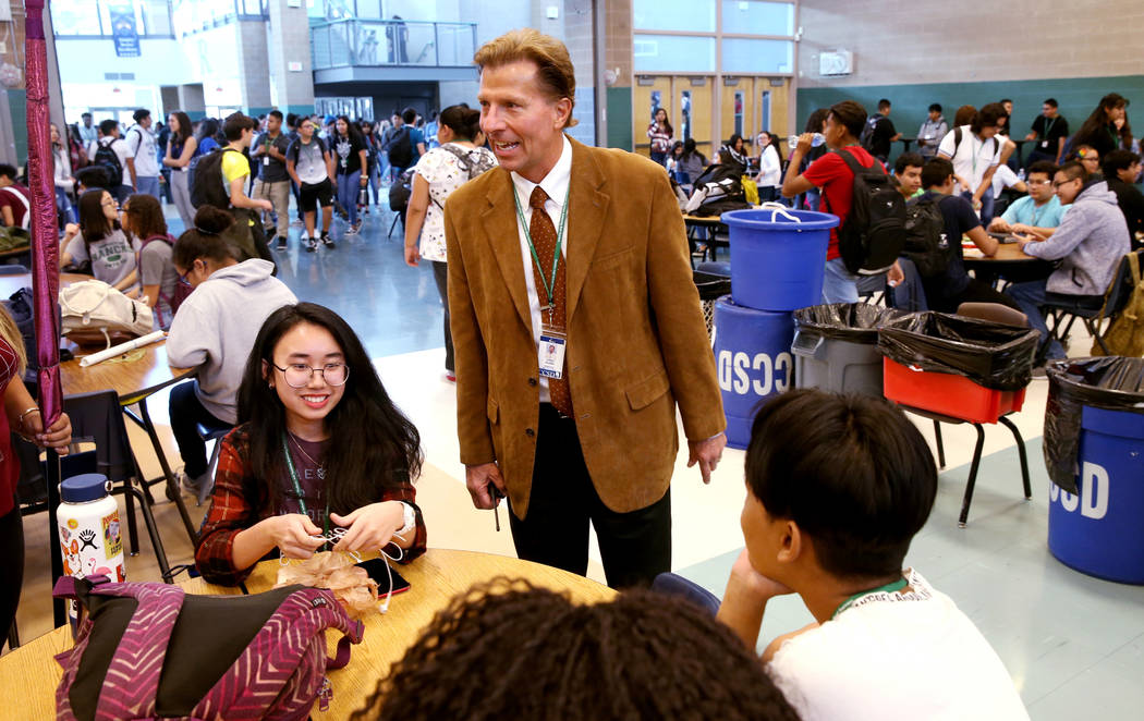 Principal James Kuzma visits with juniors Claire Pormento and Alva Yuke during first lunch at R ...