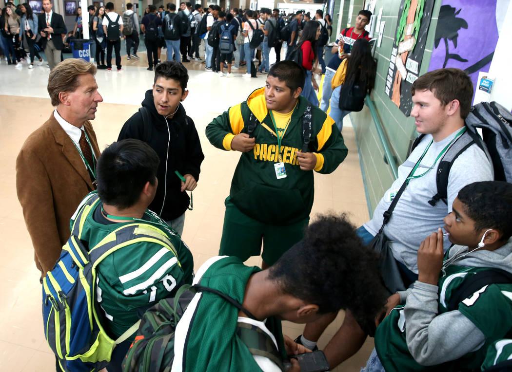 Principal James Kuzma visits with, clockwise from top left, Florentino Morado Guerrero, John Re ...
