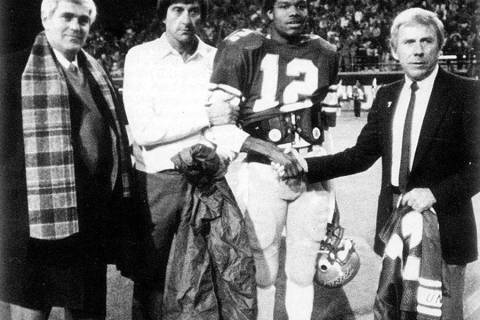 UNLV quarterback Randall Cunningham's No. 12 is retired at halftime of a 1984 game against No. ...