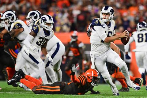Los Angeles Rams quarterback Jared Goff (16) scrambles during the first half of an NFL football ...