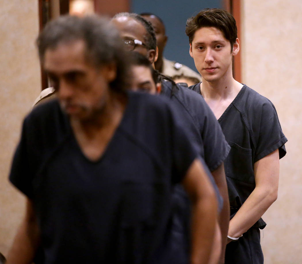 Giovanni Ruiz, 21, right, walks into the courtroom at North Las Vegas Justice Court, Tuesday, S ...