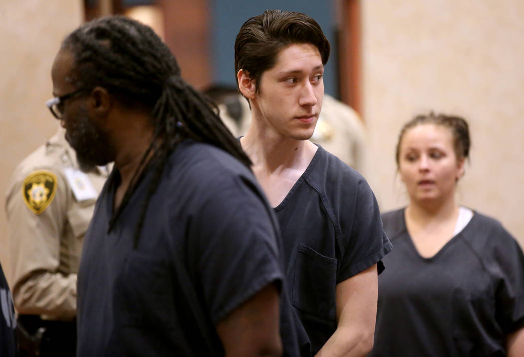 Giovanni Ruiz, 21, second from right, walks into the courtroom at North Las Vegas Justice Court ...