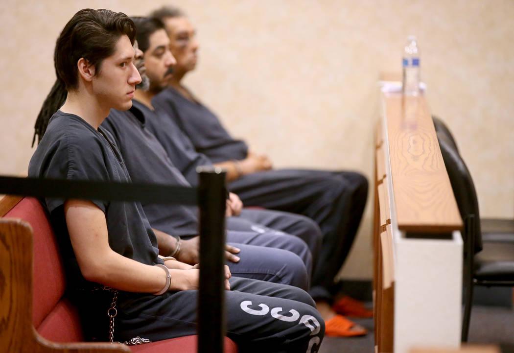 Giovanni Ruiz, 21, left, waits in North Las Vegas Justice Court, Tuesday, Sept. 24, 2019. Ruiz ...