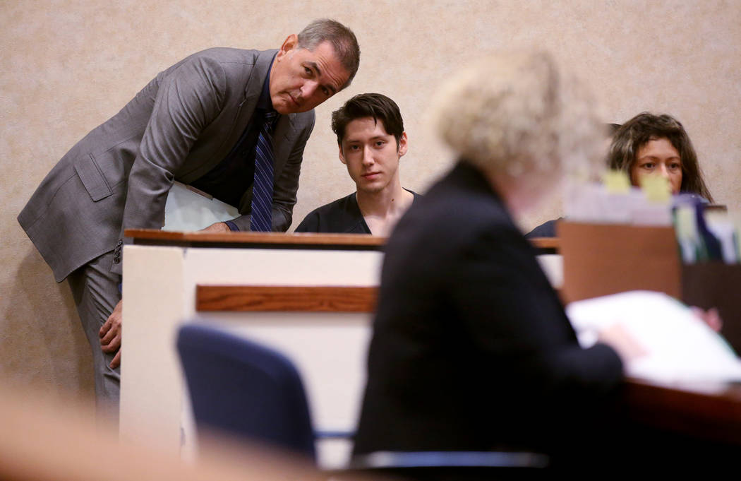 Giovanni Ruiz, 21, second from left, talks to his attorney, Gabriel Grasso, while waiting to ap ...