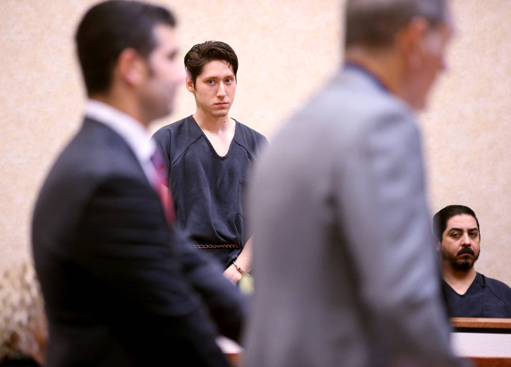 Giovanni Ruiz, 21, second from left, listens as his attorney, Gabriel Grasso, right, and prosec ...