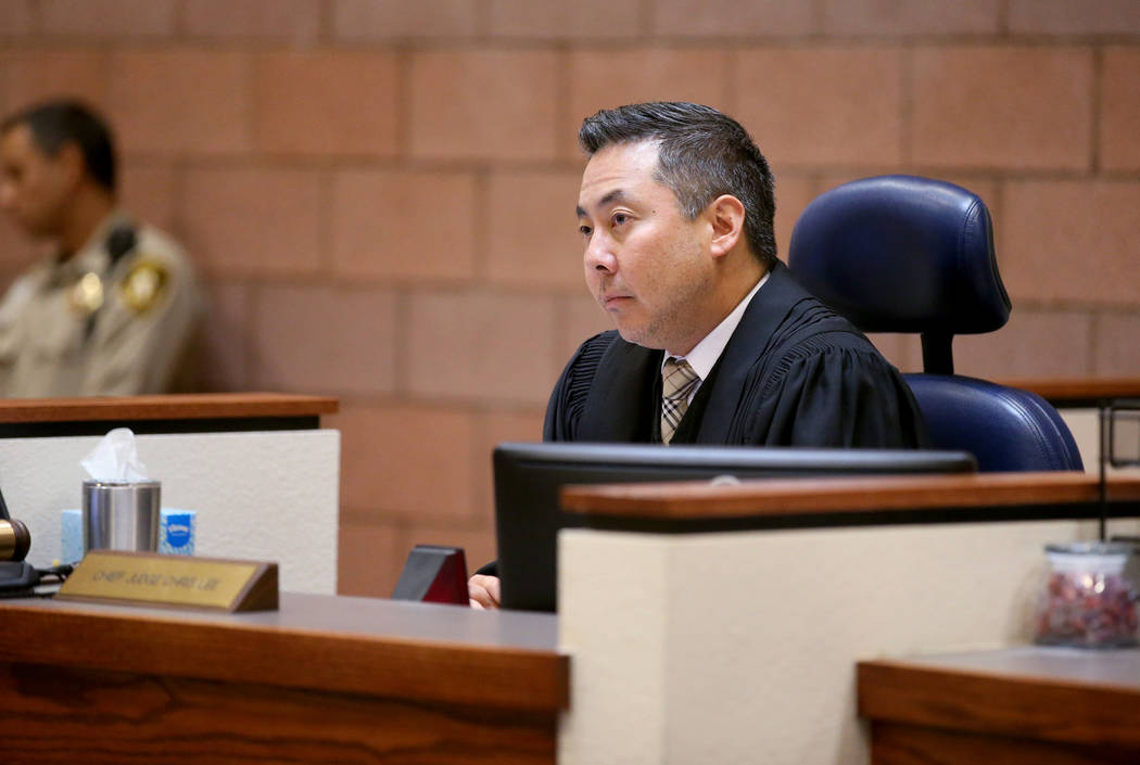 North Las Vegas Justice of the Peace Chris Lee listens to an attorney for Giovanni Ruiz, 21, Tu ...