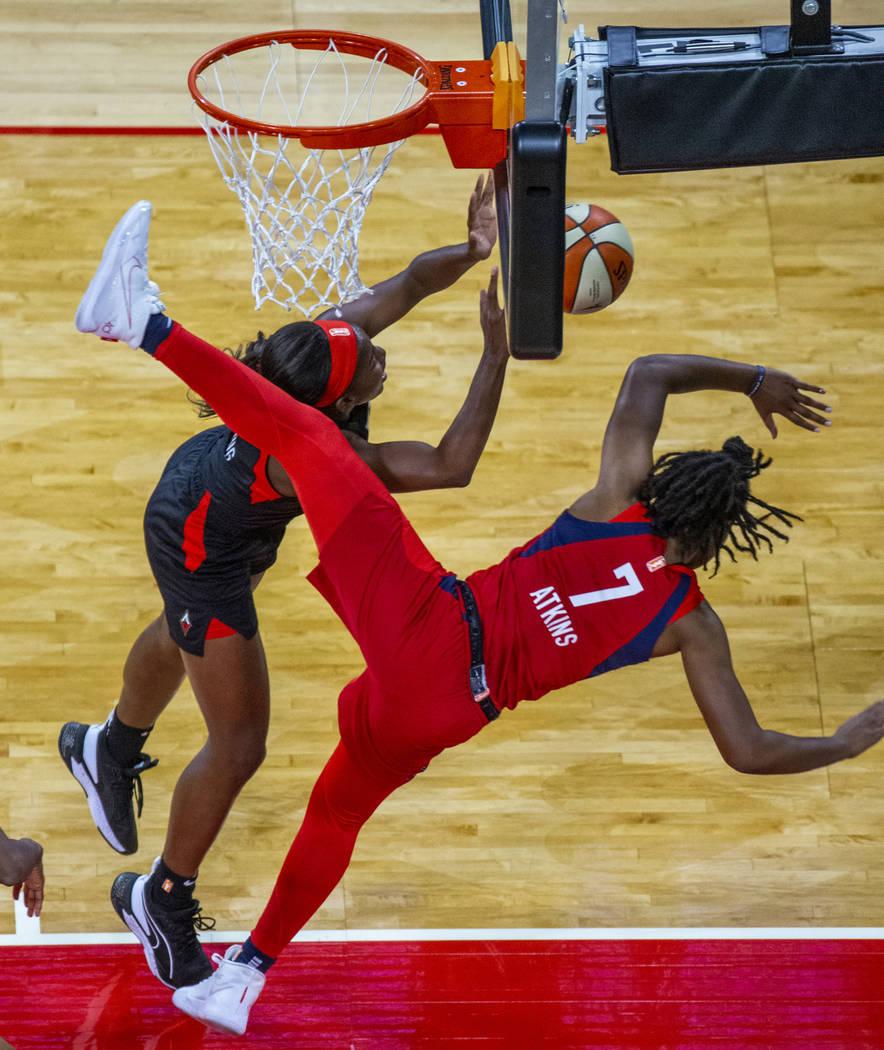Las Vegas Aces guard Jackie Young (0) is fouled hard by Washington Mystics guard Ariel Atkins ( ...