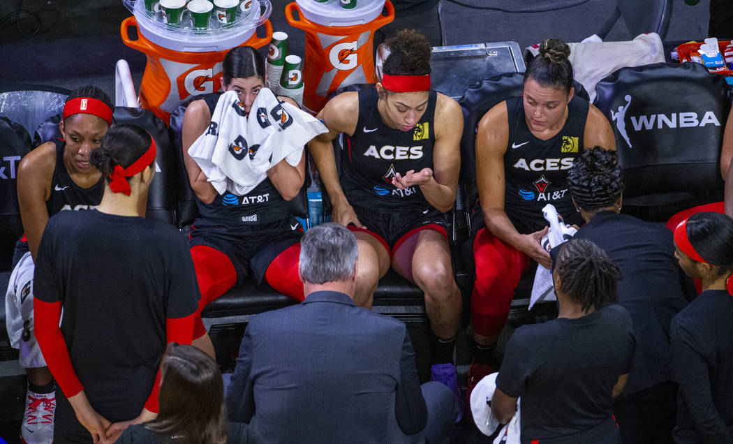 Las Vegas Aces players take a break during a timeout versus the Washington Mystics during the f ...
