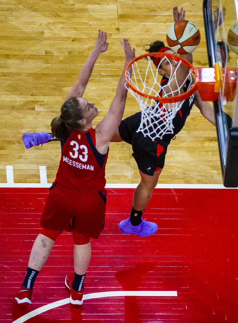Las Vegas Aces forward Dearica Hamby (5) gets inside of a basket over Washington Mystics center ...