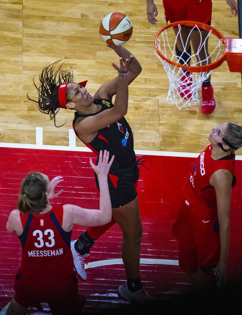 Las Vegas Aces center A'ja Wilson (22, right) looks to the basket over Washington Mystics cente ...