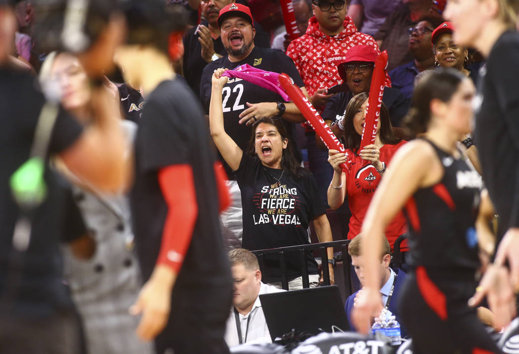 Las Vegas Aces fans react at the end of the first quarter of a WNBA semifinal basketball game a ...