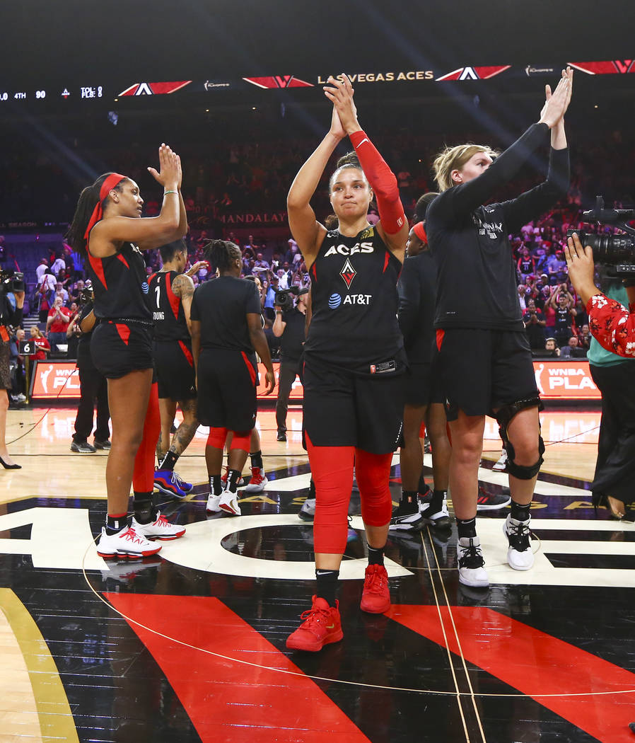 Members of the Las Vegas Aces acknowledge their fans after losing to the Washington Mystics in ...