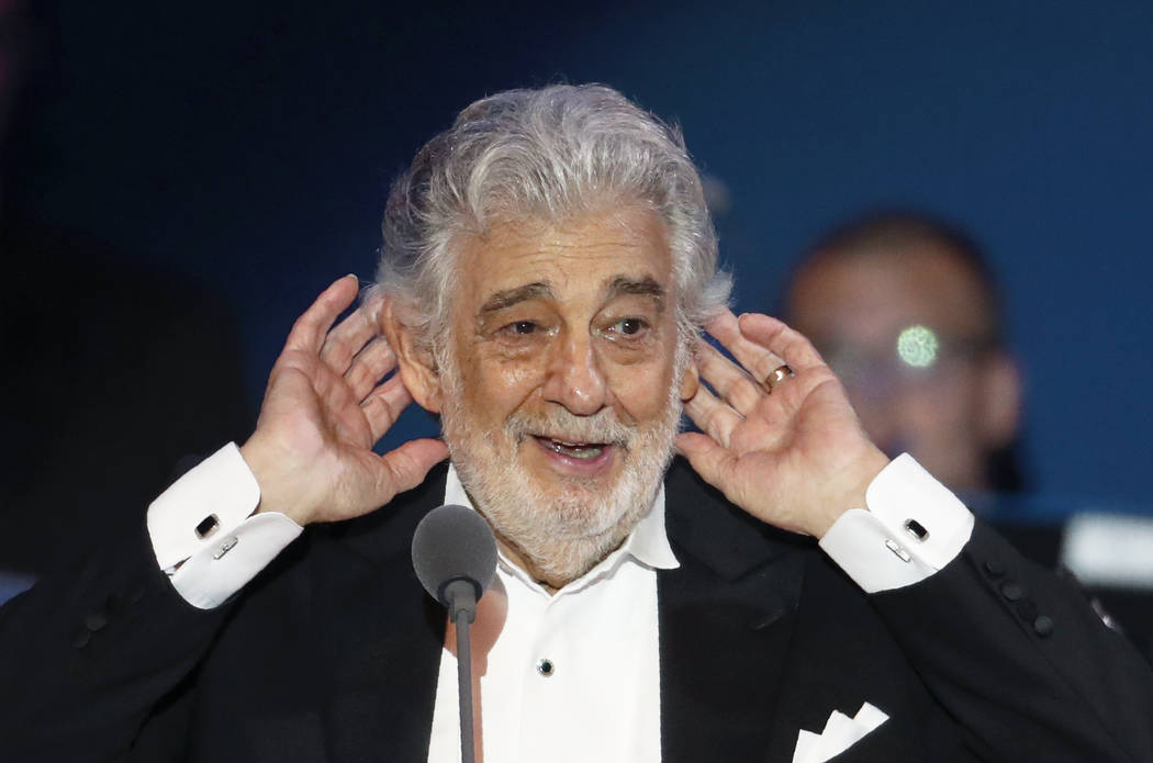 FILE - In this Aug. 28, 2019 file photo, opera star Placido Domingo listens to applause at the ...