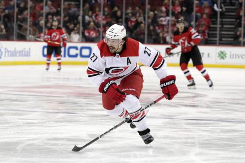 FILE - In this Feb. 10, 2019, file photo, Carolina Hurricanes defenseman Justin Faulk (27) is s ...