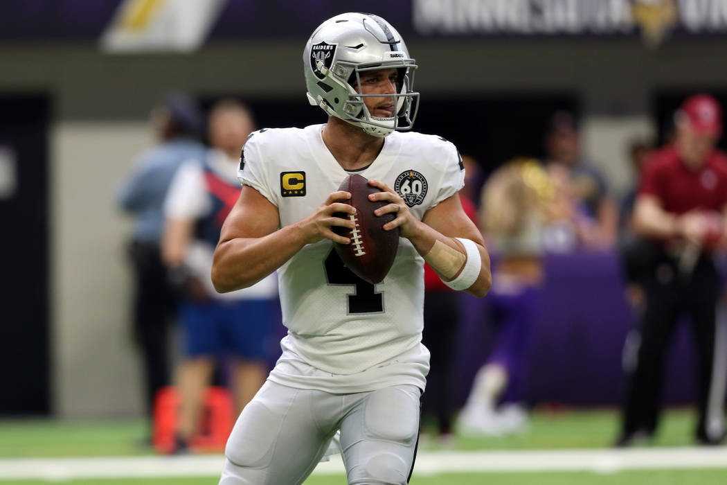 Oakland Raiders quarterback Derek Carr (4) looks for an open receiver during the first half of ...