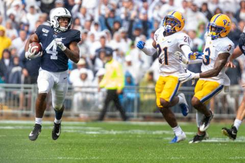 Penn State running back Journey Brown (4) breaks away on a long run in the first quarter of an ...