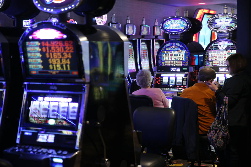 People play the slot machines at the D Las Vegas hotel-casino in Las Vegas, Friday, Aug. 23, 20 ...