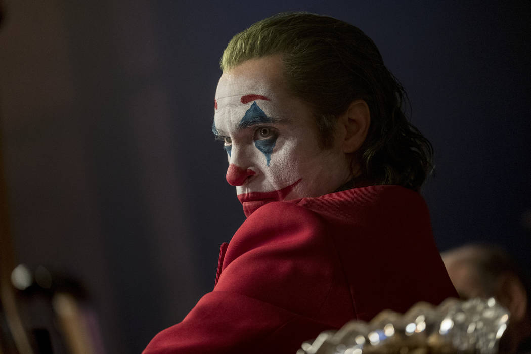 """This image released by Warner Bros. Pictures shows Joaquin Phoenix in a scene from """"Joker, ..."""