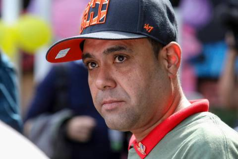 Miguel Perez Jr. listens to a supporter speaking at a news conference in Chicago on Tuesday, Se ...