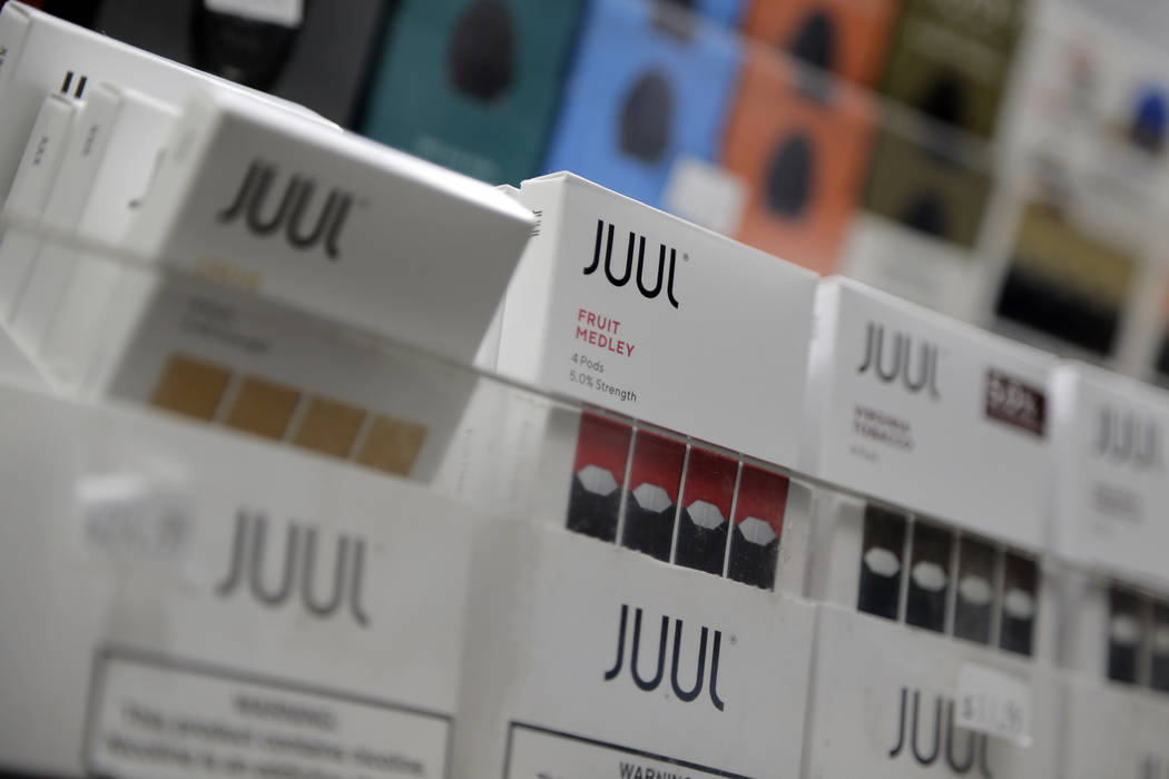 A Dec. 20, 2018, file photo shows Juul products displayed at a smoke shop in New York. Philip M ...