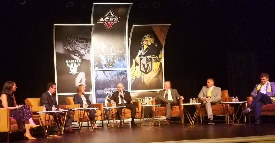 Marc Badain, center, president of the Oakland Raiders, makes a point about Allegiant Stadium, w ...
