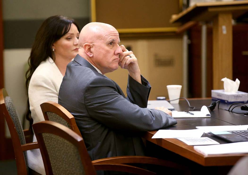 "Las Vegas police Lt. James ""Tom"" Melton listens to closing arguments with one of his ..."