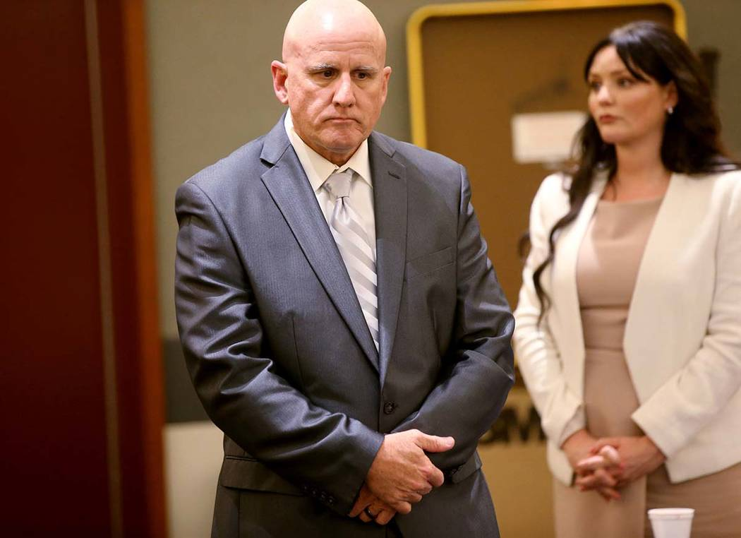 "Las Vegas police Lt. James ""Tom"" Melton and one of his attorneys, Jean Schwartzer, st ..."