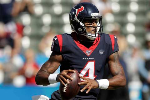 Houston Texans quarterback Deshaun Watson looks to pass against the Los Angeles Chargers during ...