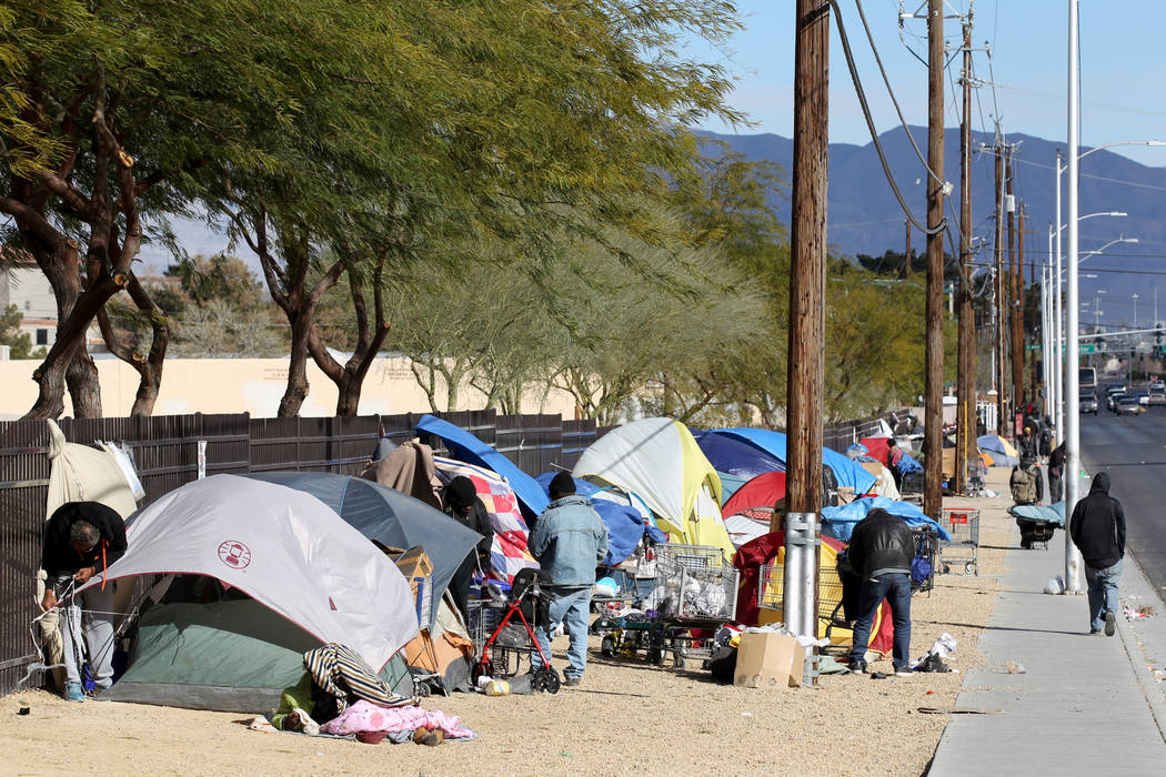 In this Feb.19 file photo, people secure their tents and tarps on Las Vegas Boulevard North ne ...