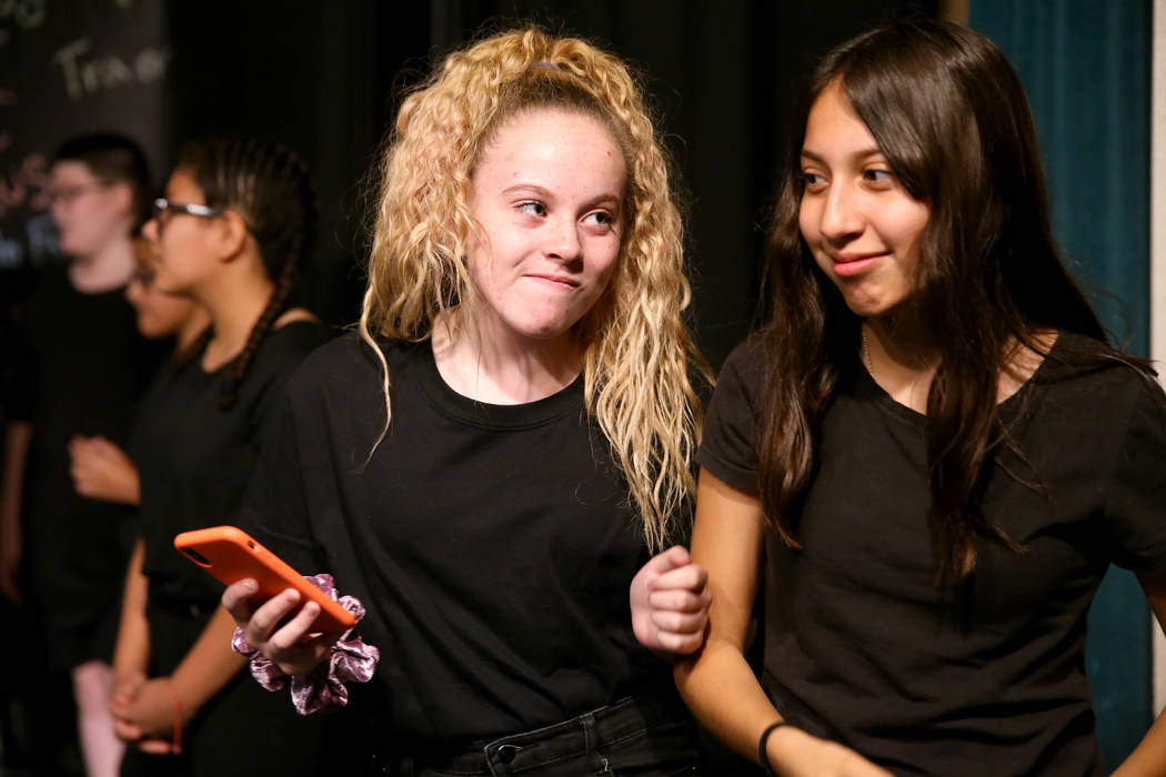 Eighth grade students Elisabeth Farris, left, and Jada Anaya cyber bully during a rehearsal for ...