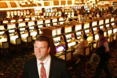 Tilman Fertitta, shown inside the Golden Nugget in Las Vegas, is expanding his business empire ...