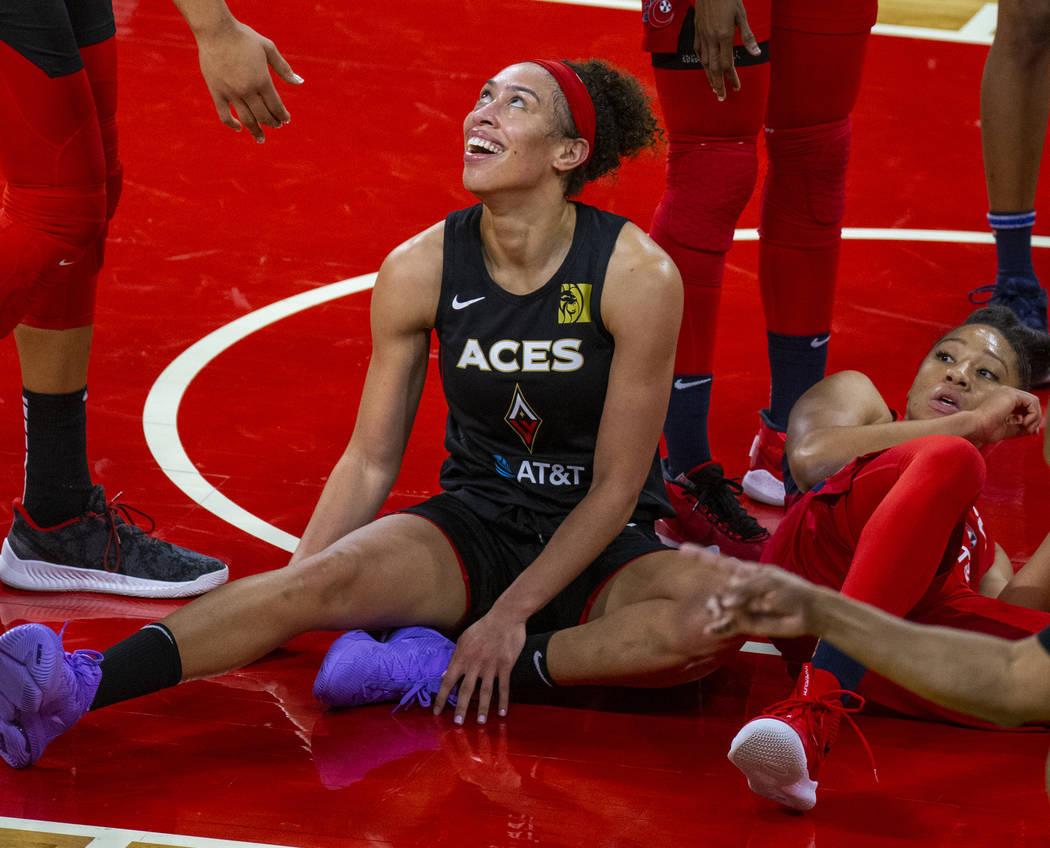 Las Vegas Aces forward Dearica Hamby (5, left) laughs after a foul from Washington Mystics forw ...