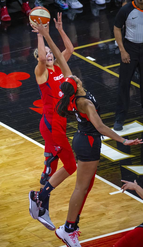 Washington Mystics forward Elena Delle Donne (11, left) gets off a shot as Las Vegas Aces cente ...