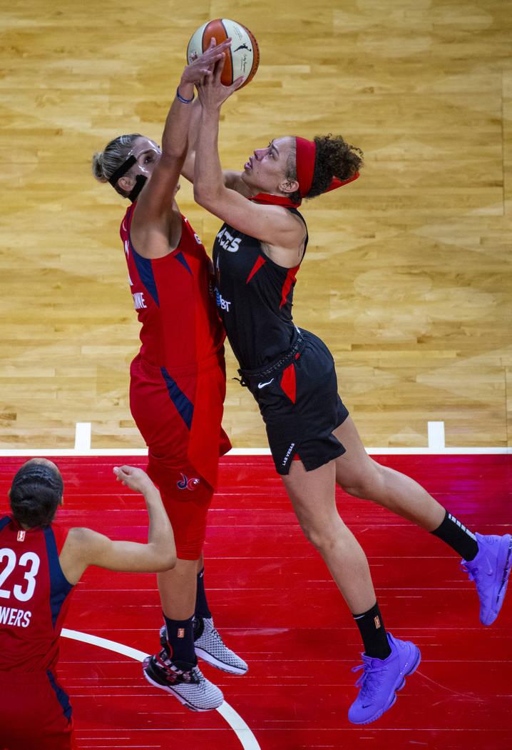 Washington Mystics forward Elena Delle Donne (11, left) makes a critical stop on Las Vegas Aces ...