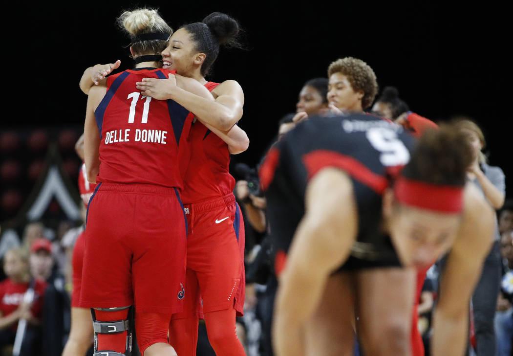 Washington Mystics' Elena Delle Donne, left, and Aerial Powers celebrate after defeating the La ...