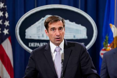 Assistant Attorney General for National Security John C. Demers, speaks during a news conferenc ...
