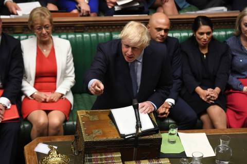 In this handout photo provided by the House of Commons, Britain's Prime Minister Boris Johnson ...
