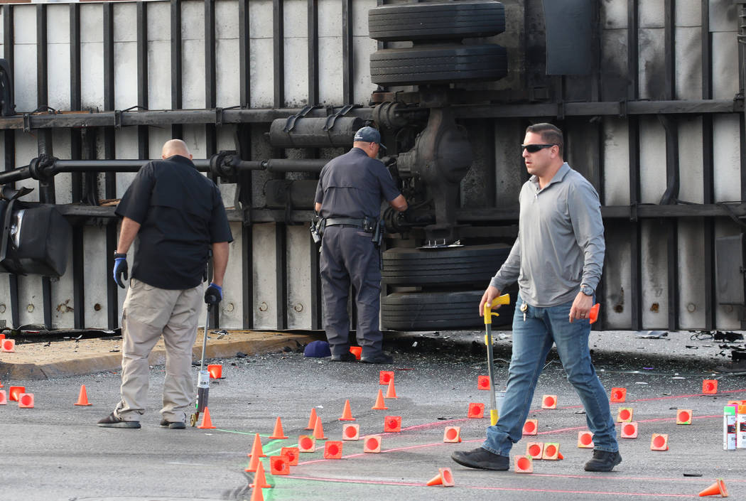 Las Vegas police investigate fatal crash involving two cars and a box truck at East Tropicana A ...