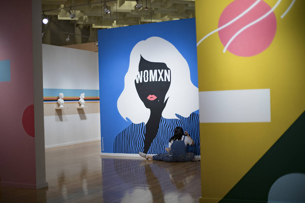 """Artist Amanda Phingbodhipakkiya touches up a mural at her show """"Connective Tissue"""" at ..."""