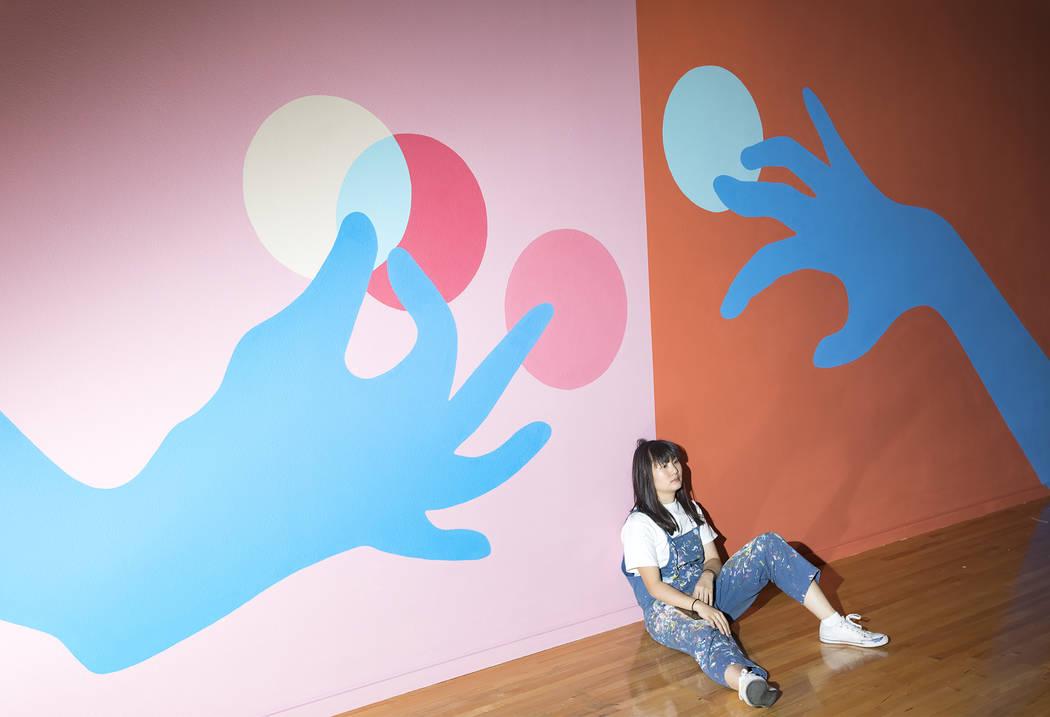 "Artist Amanda Phingbodhipakkiya takes a break while setting up her exhibition ""Connective ..."