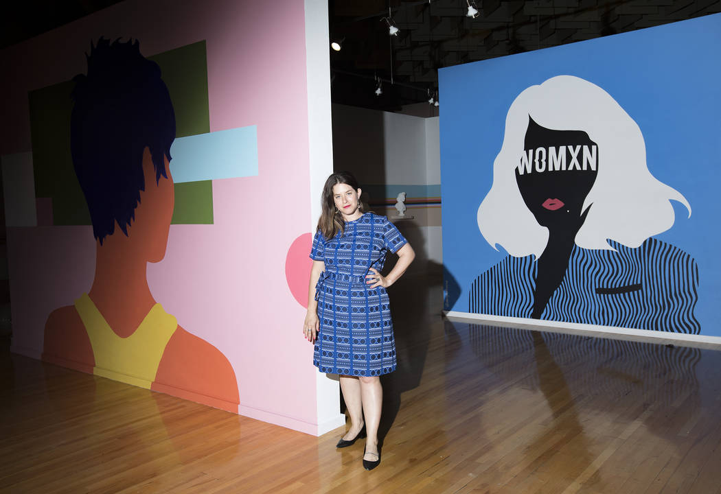 Alisha Kerlin, the Executive Director of the Marjorie Barrick Museum, stands in front of the cu ...