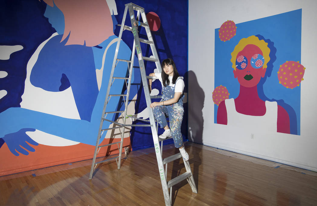 Amanda Phingbodhipakkiya, a neuroscientist-turned-artist, stands in front of her work at her ex ...