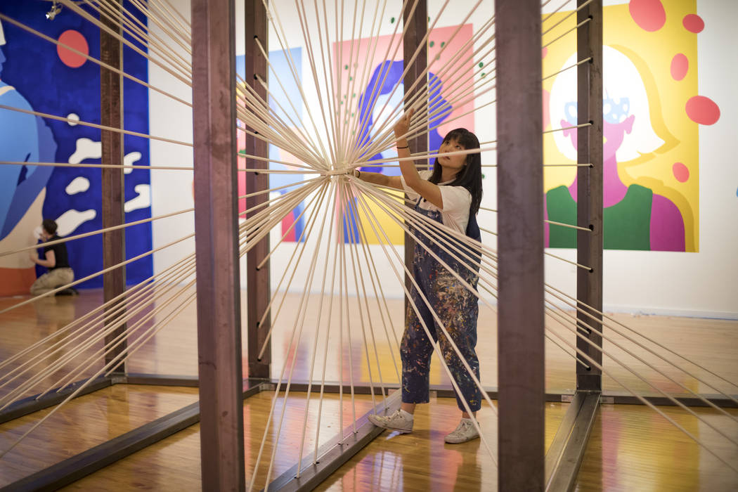 """Artist Amanda Phingbodhipakkiya sets up the installation """"There Are No Particles Only Fiel ..."""