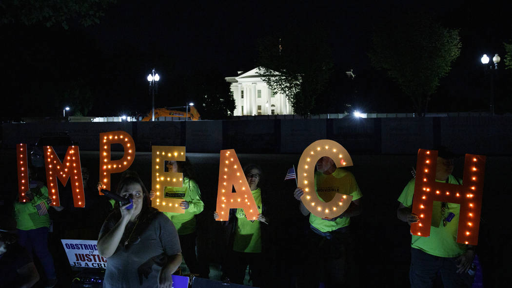"""Protesters with """"Kremlin Annex"""" call to impeach President Donald Trump in Lafayette S ..."""