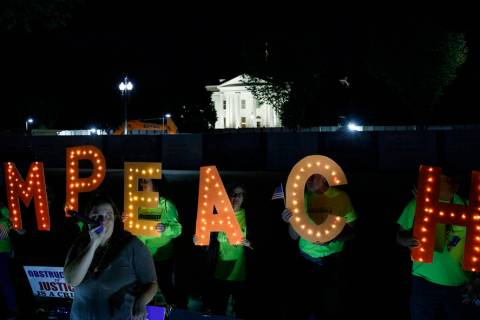"Protesters with ""Kremlin Annex"" call to impeach President Donald Trump in Lafayette S ..."