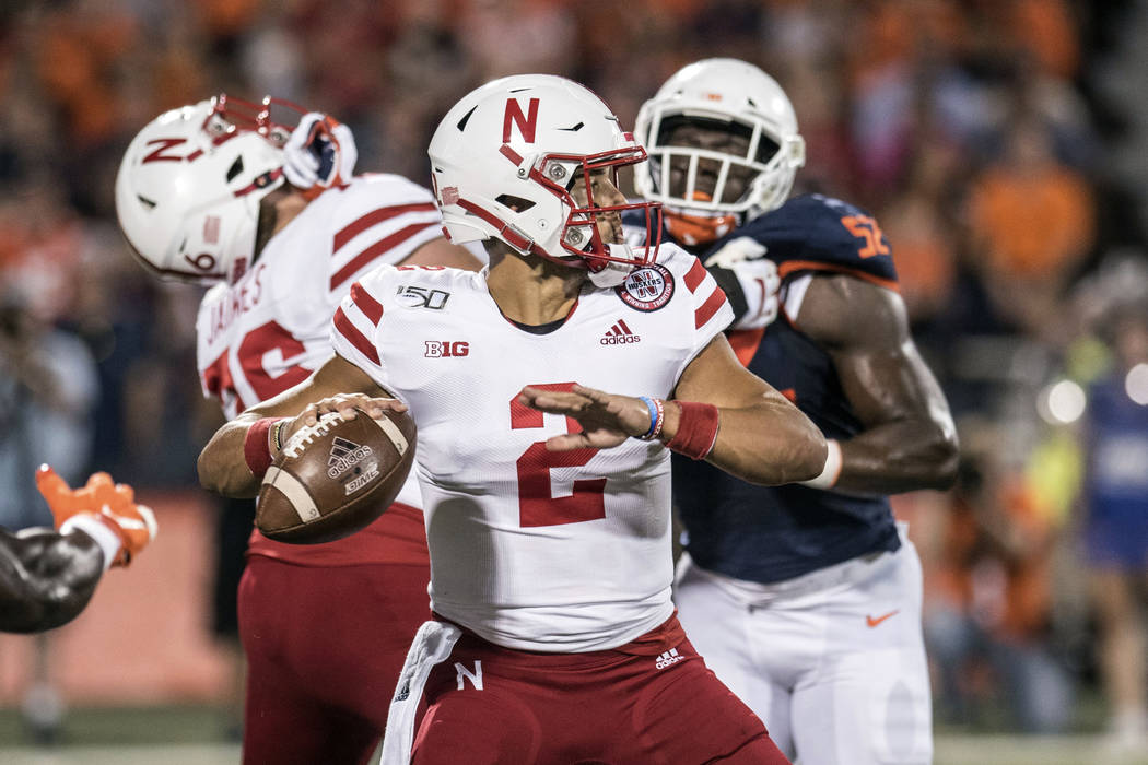 Nebraska quarterback Adrian Martinez (2) passes in the first half of an NCAA college football g ...
