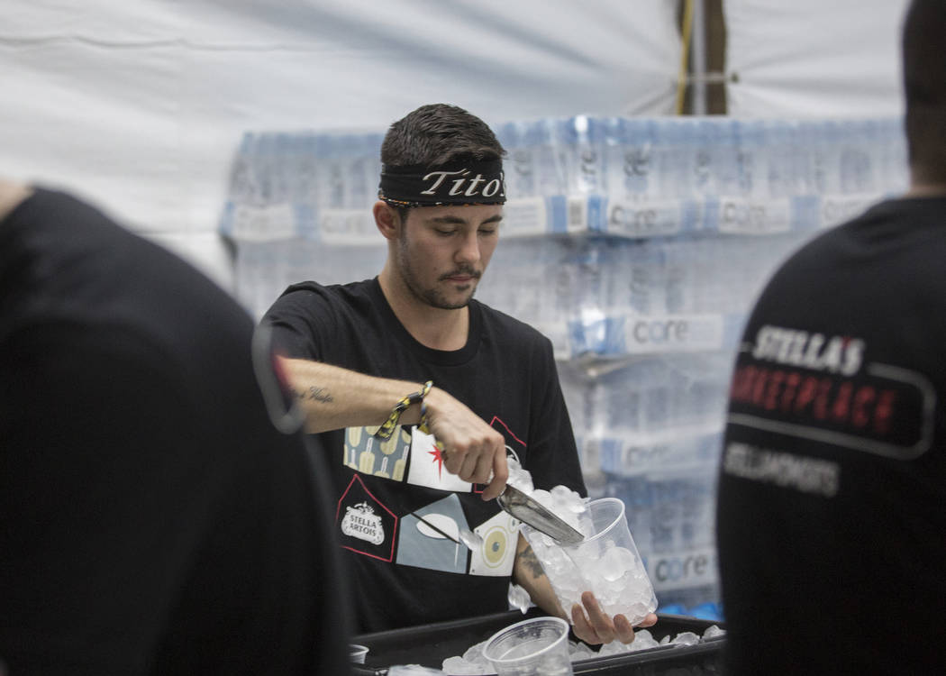 Luca Iclodean, middle, makes drinks at Life is Beautiful on Friday, Sept. 20, 2019, in Las Vega ...