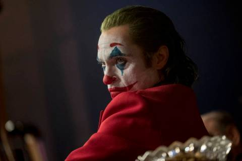 "This image released by Warner Bros. Pictures shows Joaquin Phoenix in a scene from ""Joker,"" in ..."