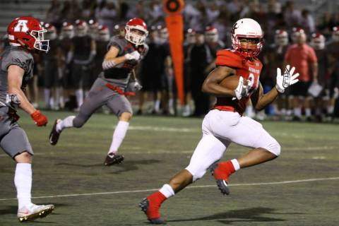 Arbor View's Daniel Mitchell (24) looks back at American Fork's Brendon Bourgeois (83) as he sp ...