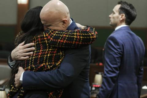 "Las Vegas police Lt. James ""Tom"" Melton, second from left, hugs defense attorney Jean ..."
